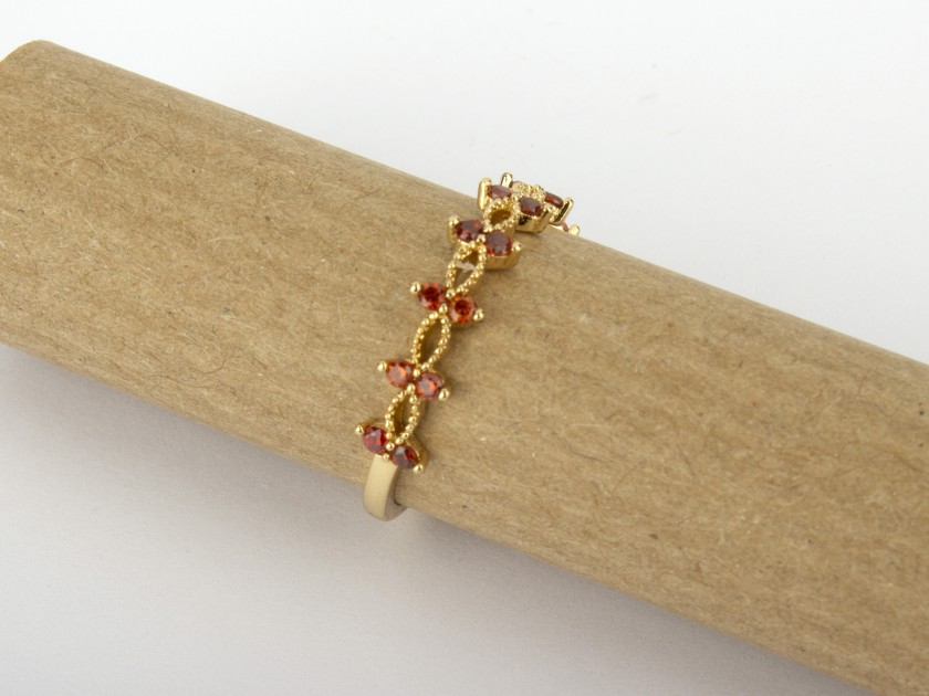 Golden ring set with red Crystals