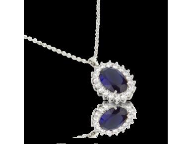 Colgante ovalado con cristales transparentes y un gran cristal azul zafiro