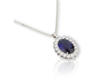 Oval Pendant set with Clear Crystals and a big Sapphire Blue Crystal