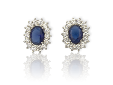 Oval Earrings set with Clear Crystals and a big Dark Blue Crystal