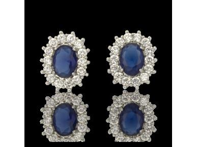 Pendientes engastados con cristales transparentes y un gran cristal azul zafiro