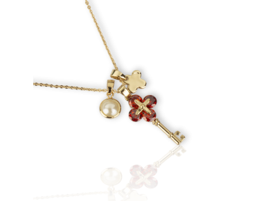 Three Charm Pendant with a Faux Pearl, a golden Key set with Red Crystals and a golden cross