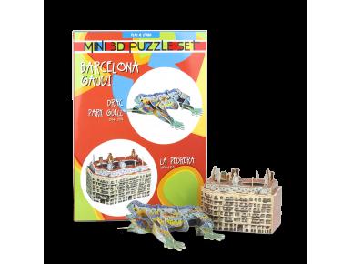Un puzzle 3D de la Pedrera y un puzzle 3D del Dragón del Parque Guëll, ambos montados delante del embalaje