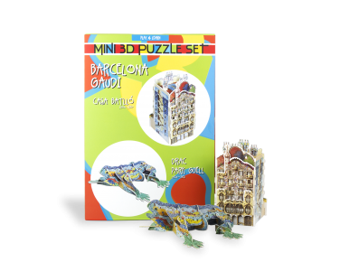 Assembled 3D puzzles of the Casa Batlló and the Dragon of Parc Guëll in front of the packaging