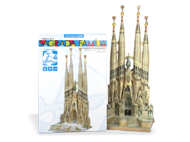 Model of the Sagrada Família assembled in front of its packaging
