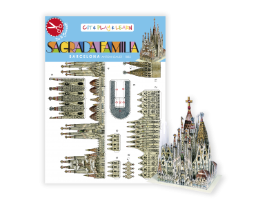 Small assembled paper model of the Sagrada Família in front of its packaging