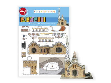 Small assembled paper model of the Guëll Park pavilion in front of its packaging