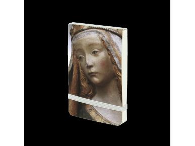 Cuaderno visto de frente con la cara de Notre Dame de Grasse impresa en la tapa