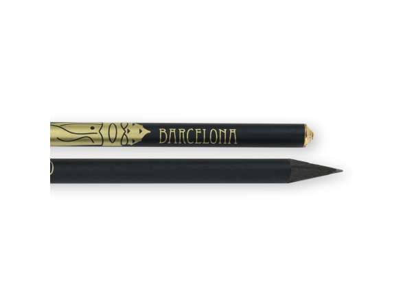 Two black pencils with a golden print of a chimney from Gaudí's monuments with a yellow crystal at the end of the pencils