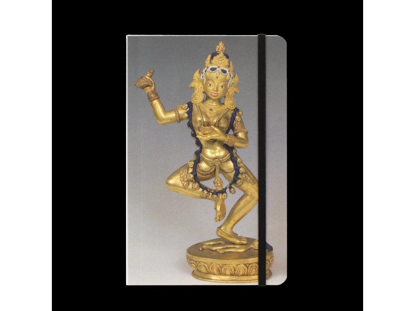 notebook with a statuette of the Buddhist goddess Vajravârâhî on the cover.