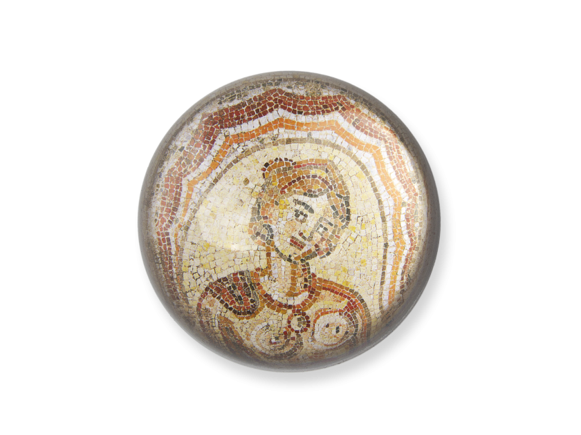 glass paperweight seen from above showing a detail of the Dotô mosaic reproduced inside
