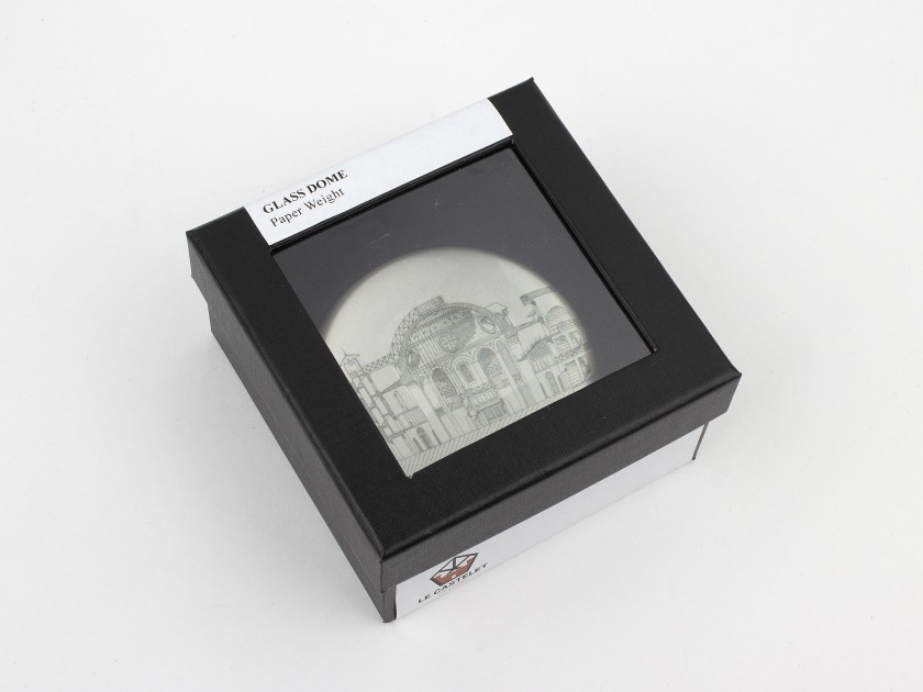 glass paperweight seen from above with a sketch of the old Castelet inside