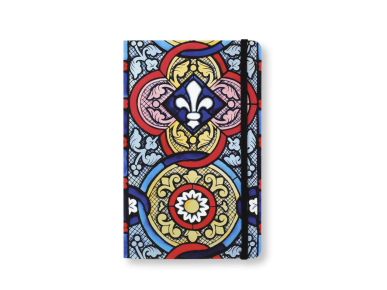 notebook seen from the front showing a cover printed with a stained glass pattern