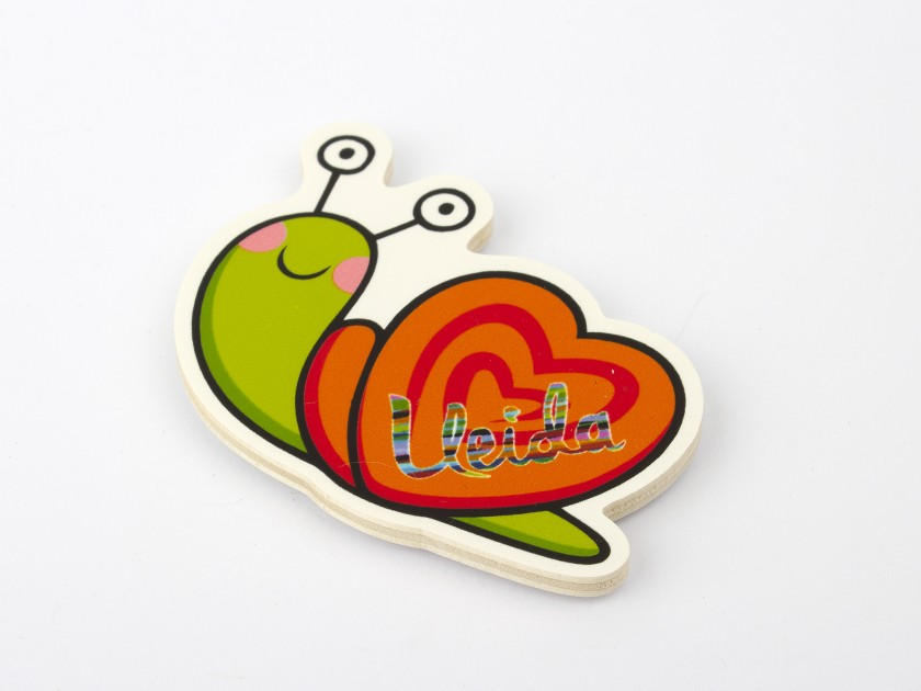 wooden magnet with a colourful snail design