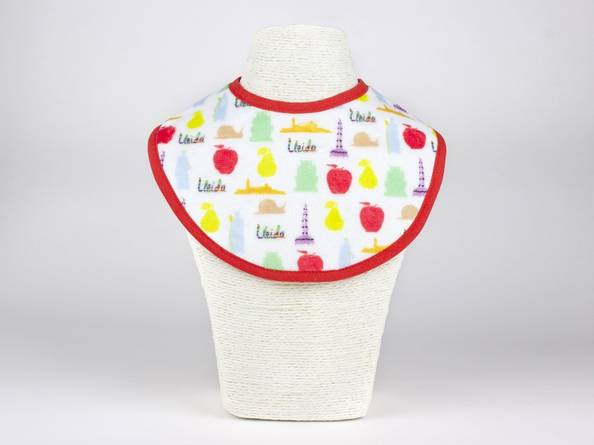 baby bib with different symbols of Catalan culture printed on it