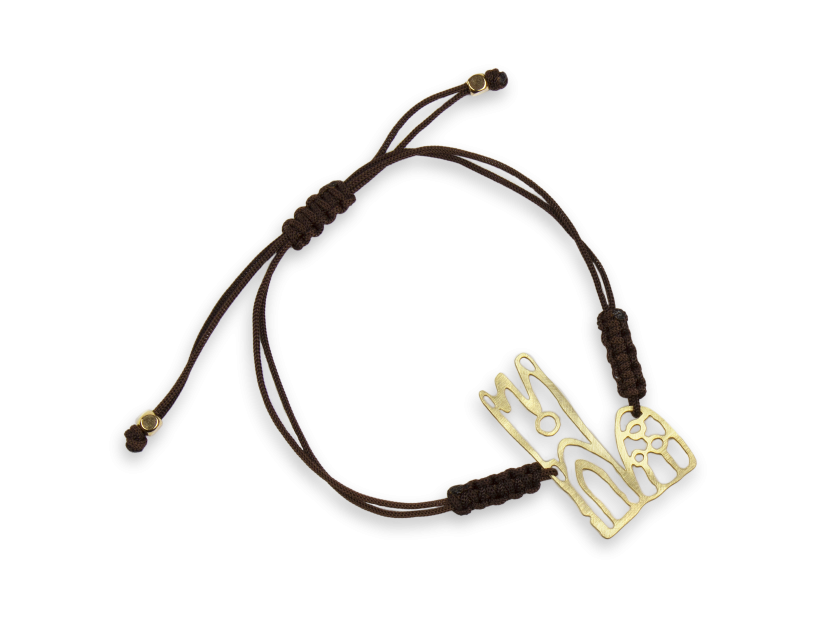 bracelet with a cord link and a representation of the cathedral of Lleida in gilded metal