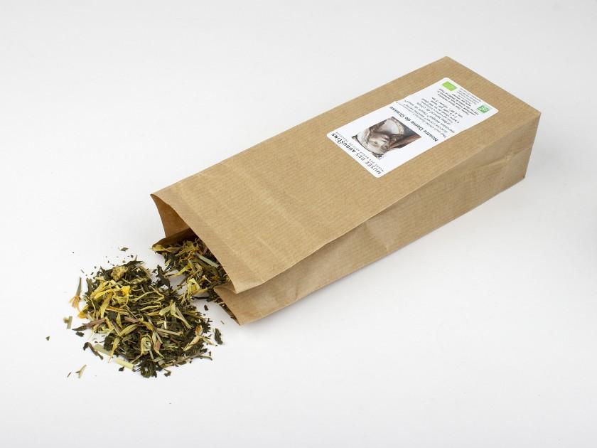 paquete de té con una etiqueta con una imagen de la cara de Notre Dame de Grasse y el nombre del Musée des Augustins