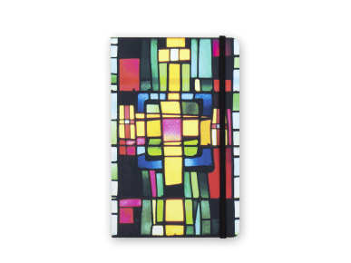 notebook seen from the front with a cover printed with coloured stained glass