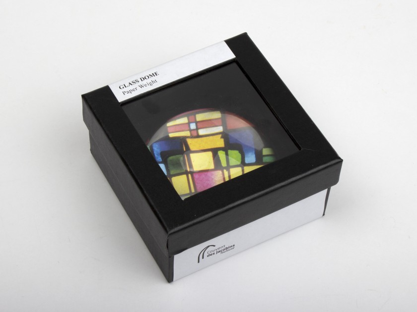 glass paperweight seen from above with a stained glass window inside