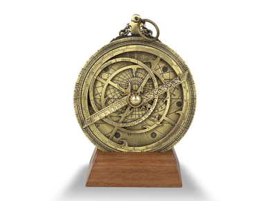 Planispheric astrolabe in gilded metal on a wooden base