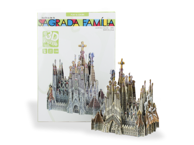 3D puzzle of the Sagrada Família assembled with its packaging in the background