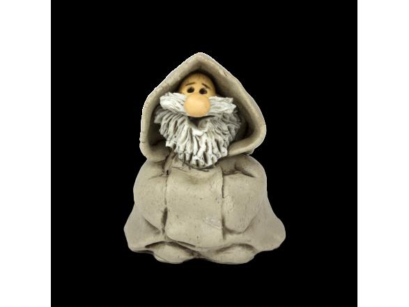 figurita de cerámica de un monje